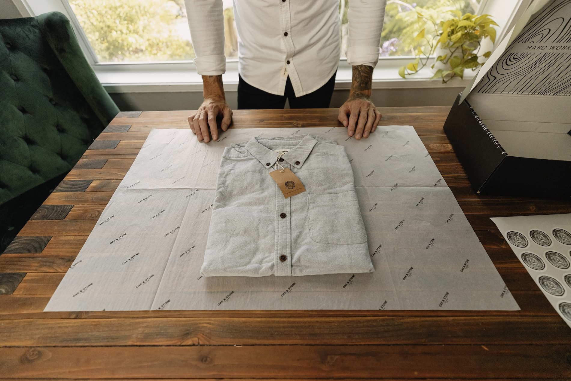 Oak & Stone shirt laid out on custom tissue paper