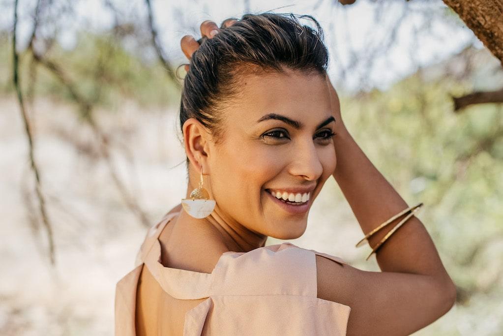 Woman wearing handmade earrings